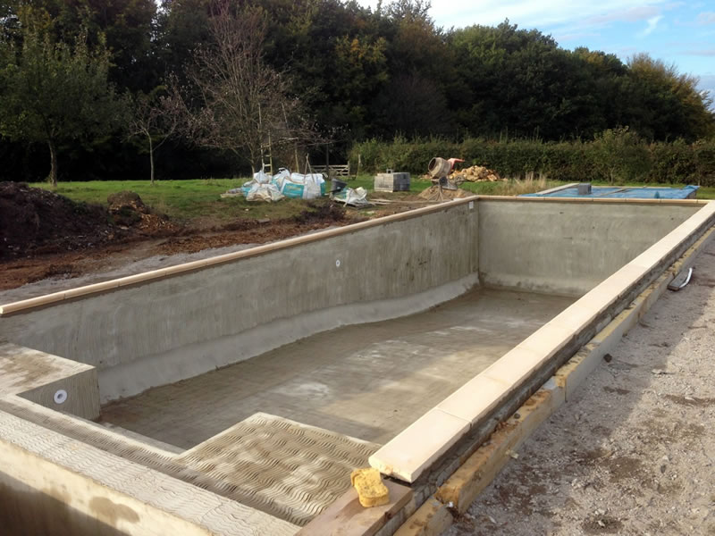 Building a bespoke swimming pool bespoke concrete swimming pool experts covering sussex for Swimming pool construction company