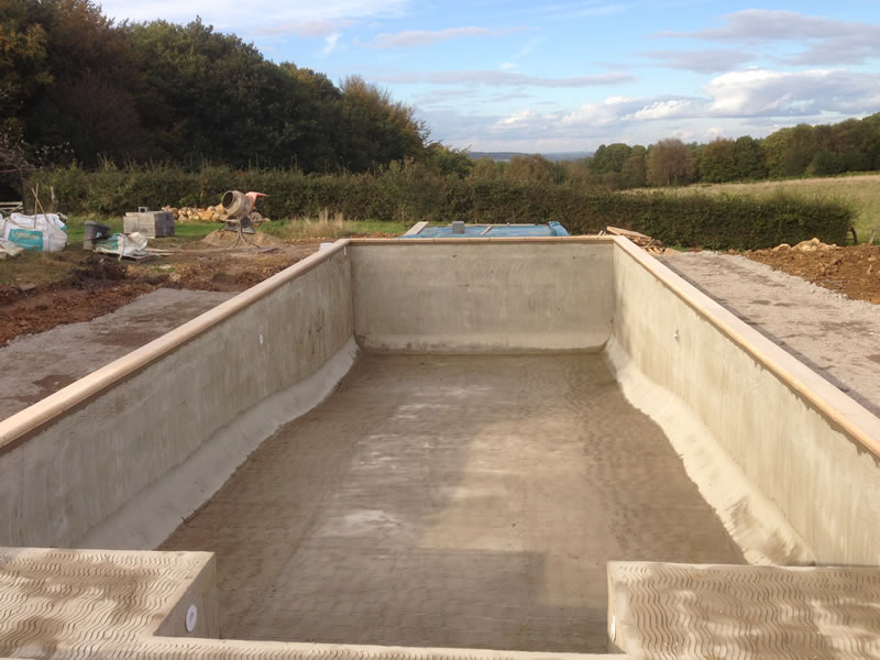 Building a bespoke swimming pool bespoke concrete for Concrete swimming pool construction